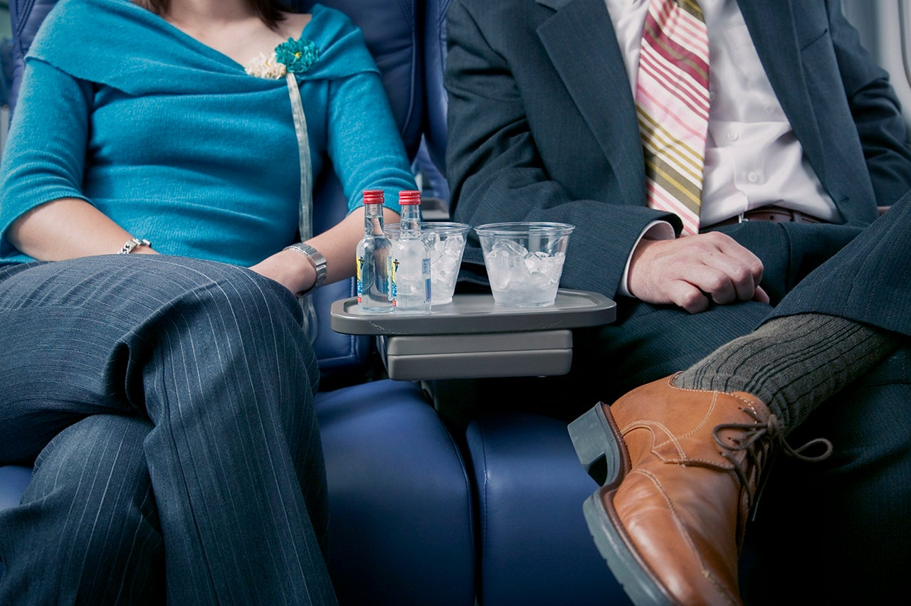 You can't drink your own alcohol that you bring on a flight